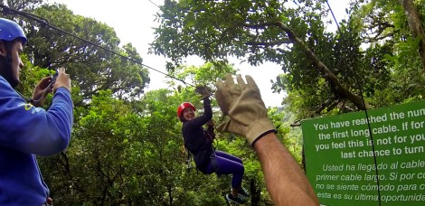 Christian waving goodbye to me. This zip line was almost a mile
